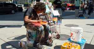 This 14 year old painter is a Toronto fixture at Yonge and Dundas