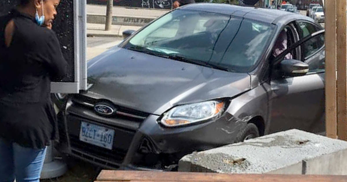 Another car nearly plowed through a bar's curb lane patio in Toronto