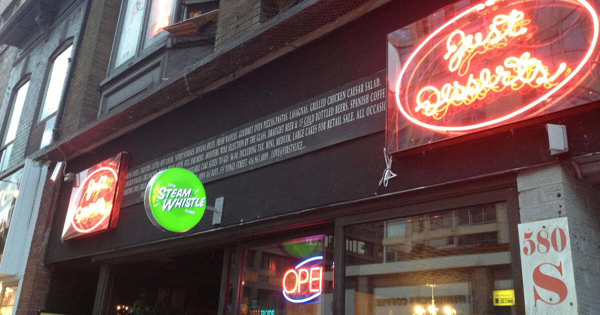 Two pink neon signs from an iconic Toronto Just Desserts location are for sale on eBay